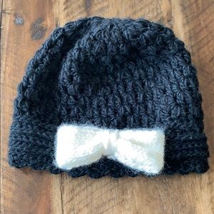 Black winter beanie with white accent bow